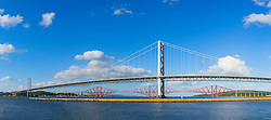 View of Forth Road Bridge and Forth Rail Bridge crossing the River Forth from South Queensferry in Scotland United Kingdom
