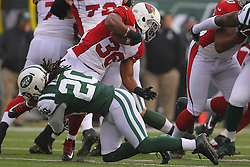 Dec 2, 2012; East Rutherford, NJ, USA; Arizona Cardinals running back LaRod Stephens-Howling (36) is tackled by New York Jets cornerback Kyle Wilson (20) during the first half at MetLIfe Stadium.