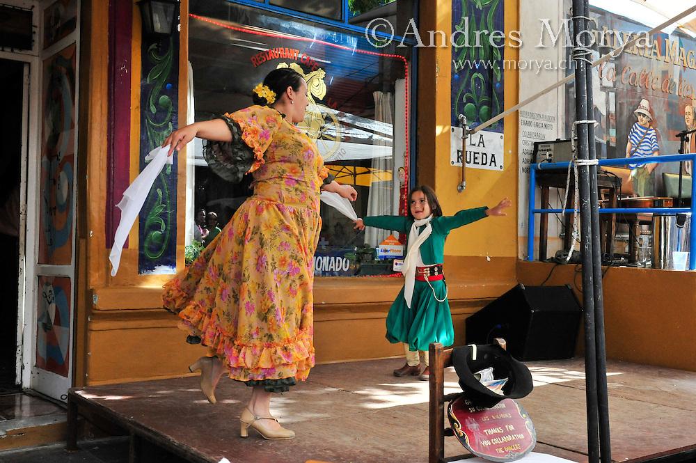 Chacarera dancers at Caminito , La Boca , Buenos Aires , Argentina Image by Andres Morya