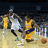 04 October 2010: Los Angeles Lakers guard Shannon Brown #12 drives past Minnesota Timberwolves guard Corey Brewer #22 during the Minnesota Timberwolves 111-92 victory over the Los Angeles Lakers, during 2010 NBA Europe Live, at the O2 Arena in London, England.