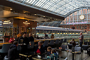 "Champagne is served at the brasserie with the new artwork entitled 'I Want My Time With You' by British (Britpop) artist Tracy Emin hangs over the main concourse at St. Pancras Station, on 10th April 2018, in London, England. In the sixth year of the Terrace Wires Commission - and in celebration of the 150th anniversary of St Pancras International and the 250th anniversary of the Royal Academy of Arts, at one of London's mainline station, the London hub for Eurostar - the 20 metre-long greeting to commuters reads 'I Want My Time With You' and Emin thinks that arriving by train and being met by a lover as they put their arms around them, is very romantic."" The Brexit-opposing artist also said she wanted to make ""a statement that reaches out to everybody from Europe arriving in to London""."