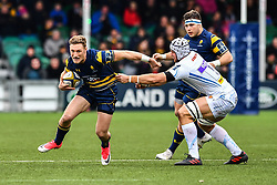 Tom Howe of Worcester Warriors evades the tackle of Toby Salmon of Exeter Chiefs - Mandatory by-line: Craig Thomas/JMP - 27/01/2018 - RUGBY - Sixways Stadium - Worcester, England - Worcester Warriors v Exeter Chiefs - Anglo Welsh Cup