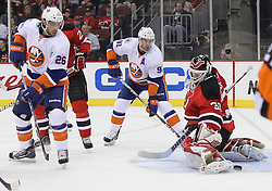 Mar 8; Newark, NJ, USA; New Jersey Devils goalie Martin Brodeur (30) makes a save while New York Islanders left wing Matt Moulson (26) looks for the rebound during the first period at the Prudential Center.