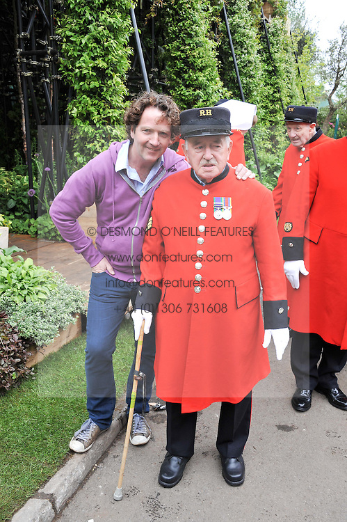 DIARMUID GAVIN and Chelsea Pensioner on show garden by Diarmuid Gavin at the 2012 RHS Chelsea Flower Show held at Royal Hospital Chelsea, London on 21st May 2012.