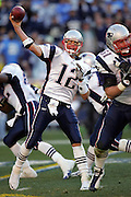 SAN DIEGO - JANUARY 14:  Quarterback Tom Brady #12 of the New England Patriots unloads a pass as he leads his team to a fourth quarter comeback win over the San Diego Chargers at the AFC Divisional Playoff Game held on January 14, 2007 at Qualcomm Stadium in San Diego, California. The Patriots defeated the Chargers 24-21. ©Paul Anthony Spinelli *** Local Caption *** Tom Brady