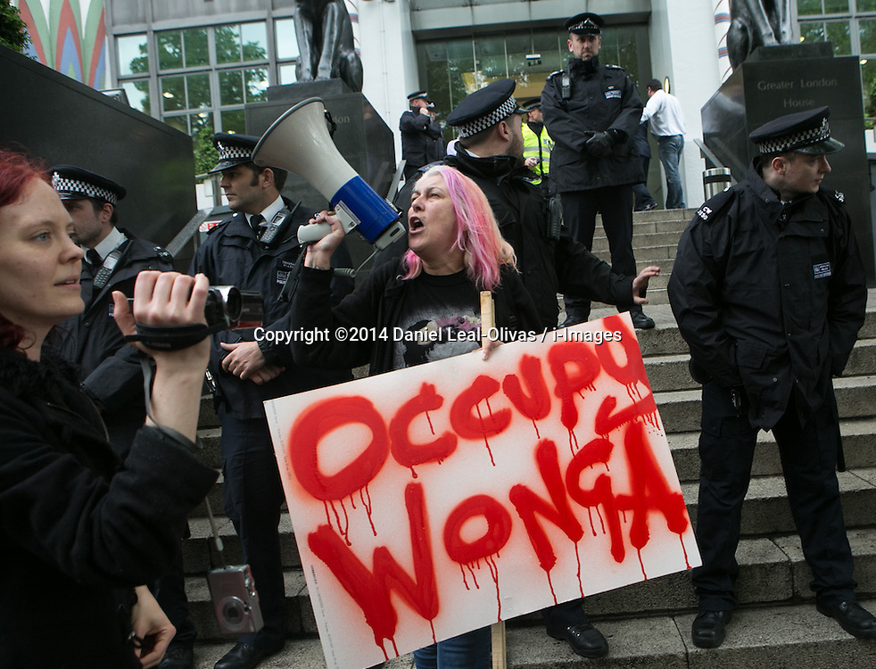 Occupy Wonga May Day. Protester from Occupy London shouts words against the Loan company Wonga in an improvised demonstration trough London from Trafalgar Square till the Wonga offices in front Harrington Square. Central London, United Kingdom. Thursday, 1st May 2014. Picture by Daniel Leal-Olivas / i-Images