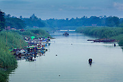 06 JUNE 2014 - IRRAWADDY DELTA,  AYEYARWADY REGION, MYANMAR: A canal in Pantanaw, a town in the Irrawaddy Delta (or Ayeyarwady Delta) in Myanmar. The region is Myanmar's largest rice producer, so its infrastructure of road transportation has been greatly developed during the 1990s and 2000s. Two thirds of the total arable land is under rice cultivation with a yield of about 2,000-2,500 kg per hectare. FIshing and aquaculture are also important economically. Because of the number of rivers and canals that crisscross the Delta, steamship service is widely available.   PHOTO BY JACK KURTZ