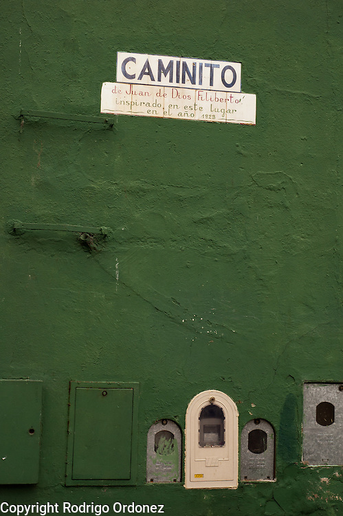 A sign indicates that the tango song 'Caminito' was inspired by this place, Caminito street, in La Boca neighborhood of Buenos Aires, Argentina.<br /> Caminito is a pedestrian street created in the late 1950s by local painter Benito Quinquela Mart&iacute;n and other artist friends to recreate a version of the old immigrant neighborhood of La Boca, using wood and corrugated zinc painted in bright colors. Today, Caminito and the surrounding areas feature cafes, souvenir shops, tango dancers and other street performances aimed to attract tourists.