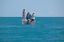 Tourists from a charter boat watch for whales in Camden Sound on the Kimberley coast.