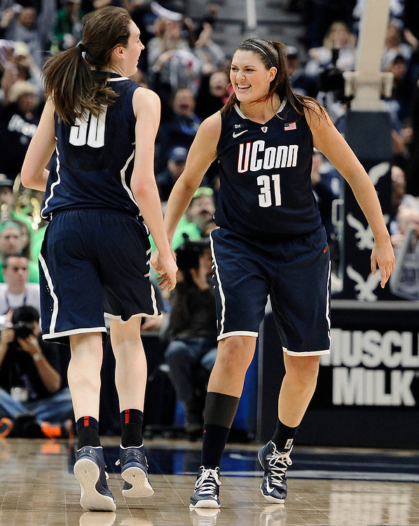 Connecticut's Breanna Stewart, left, and Connecticut's Stefanie Dolson celebrate in the second half of an NCAA college basketball game in the final of the Big East Conference women's tournament in Hartford, Conn., Tuesday, March 12, 2013. Notre Dame won 61-59. (AP Photo/Jessica Hill)