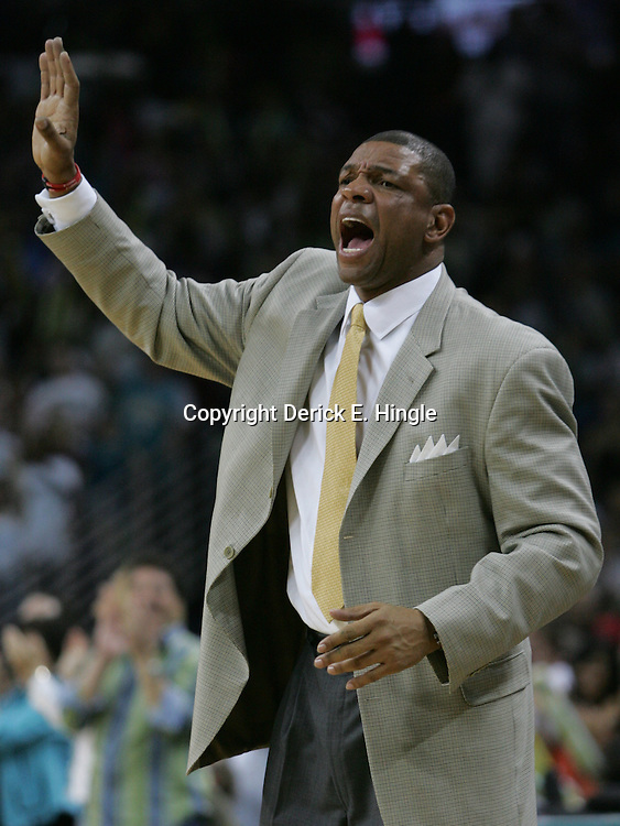 Boston Celtics head coach Doc Rivers yells to his bench in the fourth quarter of their NBA game on March 22, 2008 at the New Orleans Arena in New Orleans, Louisiana. The New Orleans Hornets defeated the Boston Celtics 113-106.