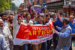 August 1, 2018 - Srinagar, Jammu & Kashmir, India - Members of Civil society of Kashmir Shouts slogans during protest against the proposed removal of Article 35A in the state..Kashmiri civil society members hold protest in press enclave of Srinagar on Wednesday against the proposed removal of Article 35A in the state of Jammu and Kashmir. Article 35A, the Jammu and Kashmir State Subject Law which defines permanent residents of the state to buy and own property in state and prevents non-locals from buying or owning property in the state. (Credit Image: © Abbas Idrees/SOPA Images via ZUMA Wire)