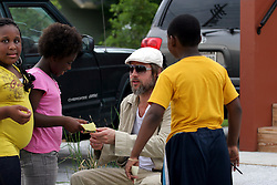 31 May 2010. New Orleans, Louisiana, USA.  <br /> Brad Pitt and signs autographs for Lower ninth ward kids on the set of Spike Lee's latest movie,  'If God is Willing and the Creek Don't Rise.'<br /> Photo; Charlie Varley.