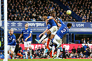 Chelsea forward Tammy Abraham (9) challenges Everton forward Dominic Calvert-Lewin (9) and Everton defender Mason Holgate (2) during the Premier League match between Everton and Chelsea at Goodison Park, Liverpool, England on 7 December 2019.