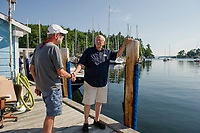 """Ed Heirs shares memories from 45 years ago when Merrill Fay launched his boating career.  """"He (Merrill Fay) saved me on the water a couple of times back then - a patient man.    (Karen Bobotas/for New England Boating)"""