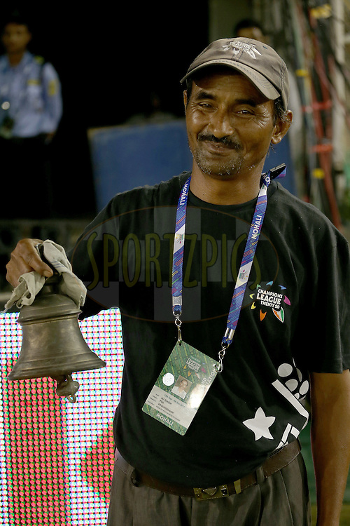 Official match bell being rung at the start of match 2 of the Oppo Champions League Twenty20 between the Kings XI Punjab and the Hobart Hurricanes held at the Punjab Cricket Association Stadium, Mohali, India on the 18th September 2014. Photo by:  Jacques Rossouw / Sportzpics/ CLT20<br /> <br /> <br /> Image use is subject to the terms and conditions as laid out by the BCCI/ CLT20.  The terms and conditions can be downloaded here:<br /> <br /> http://sportzpics.photoshelter.com/gallery/CLT20-Image-Terms-and-Conditions-2014/G0000IfNJn535VPU/C0000QhhKadWcjYs