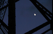 Salisbury Mills, NY - The moon seen through the girders of the Moodna Viaduct on Nov. 28, 2009.