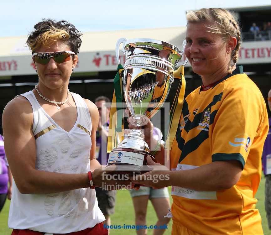 Picture by Stephen Gaunt/Focus Images Ltd +447904 833202<br /> 14/07/2013<br /> Karyn Murphy (R) of Australia receive the 2013 Womon Rugby League Trophy from Sophie Cox Olympic Judo Medalist during the Womens Rugby League World Cup Final match at Headingley Carnegie Stadium, Leeds.