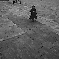A women walks around the Kremlin in Moscow, Russia.