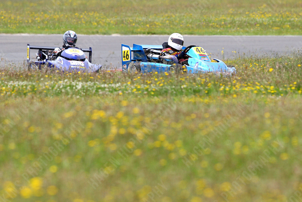Tony Gestro, 46, and Darryn Waugh, 8, race in the International Superkarts class during the 2012 Superkart National Champs and Grand Prix at Manfeild in Feilding, New Zealand on Saturday, 7 January 2011. Credit: Hagen Hopkins.