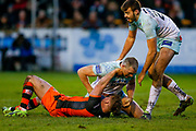 Castleford Tigers loose forward Adam Milner (13) is held by Widnes Vikings loose forward Chris Houston (11)  during the Betfred Super League match between Castleford Tigers and Widnes Vikings at the Jungle, Castleford, United Kingdom on 11 February 2018. Picture by Simon Davies.