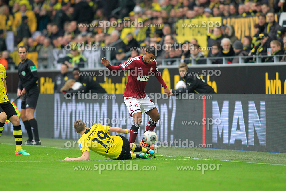 01.03.2014, Signal Iduna Park, Dortmund, GER, 1. FBL, Borussia Dortmund vs 1. FC Nuernberg, 23. Runde, im Bild Martin Angha (1 FC Nuernberg #6) im Zweikampf gegen / tackling against Kevin Grosskreutz (Borussia Dortmund #19), Aktion, Action // during the German Bundesliga 23th round match between Borussia Dortmund and 1. FC Nuernberg at the Signal Iduna Park in Dortmund, Germany on 2014/03/01. EXPA Pictures &copy; 2014, PhotoCredit: EXPA/ Eibner-Pressefoto/ Schueler<br /> <br /> *****ATTENTION - OUT of GER*****