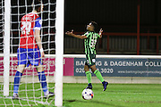 Lyle Taylor forward for AFC Wimbledon (33) makes it 0-2 and celebrates during the Sky Bet League 2 match between Dagenham and Redbridge and AFC Wimbledon at the London Borough of Barking and Dagenham Stadium, London, England on 19 April 2016. Photo by Stuart Butcher.