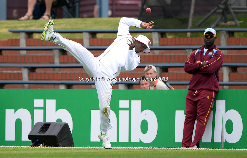 Tino Best attempts to take a catch and a chance to dismiss Trent Boult on Day 2 of the 2nd cricket test match of the ANZ Test Series. New Zealand Black Caps v West Indies at The Basin Reserve in Wellington. Thursday 12 December 2013. Mandatory Photo Credit: Andrew Cornaga www.Photosport.co.nz