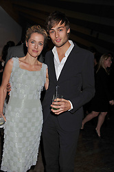 GILLIAN ANDERSON and DOUGLAS BOOTH at a dinner hosted by Calvin Klein Collection to celebrate the future Home of The Design Museum at The Commonwealth Institute, Kensington, London on 13th October 2011.