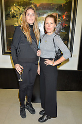 Left to right, FREDERICA LOVELL-PANK and DAVINA HARBORD at a private view of work by Christian Hook in aid of Children in Crisis held at Clarendon Fine Art, 46 Dover Street, London on 17th March 2016.