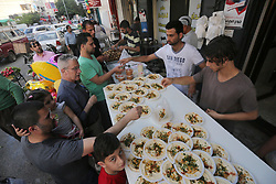 June 7, 2017 - Gaza City, Gaza Strip, Palestinian Territory - Palestinian vendors prepare chickpeas known as ''Hummus'' for breakfasting on the Muslim holy fasting month of Ramadan in Gaza city, on June 03, 2017. Ramadan is sacred to Muslims because it is during that month that tradition says the Koran was revealed to the Prophet Mohammed. The fast is one of the five main religious obligations under Islam. More than 1.5 billion Muslims around the world will mark the month, during which believers abstain from eating, drinking, smoking and having sex from dawn until sunset  (Credit Image: © Mohammed Asad/APA Images via ZUMA Wire)