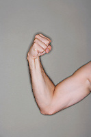 Man flexing biceps close-up on arm