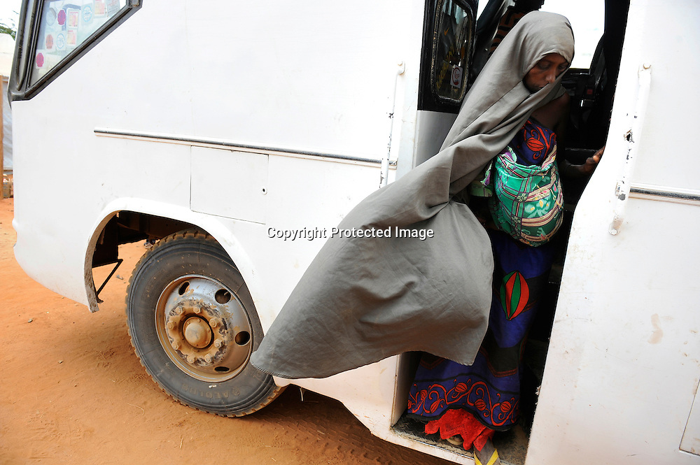 Somali refugees arrive by bus at the camps in Dadaab, Kenya.
