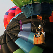 A balloon ascends during an afternoon flight at the annual Hot Air Balloon Festival in Indianola, Iowa.
