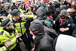 © Licensed to London News Pictures. 19/03/2016. London, UK. Police clash with protestors next to a small Britain First counter-demonstration. Thousands march through central London on UN anti-racism day to demand that the British government accept a greater share of refugees seeking asylum in Europe. Photo credit : Rob Pinney/LNP