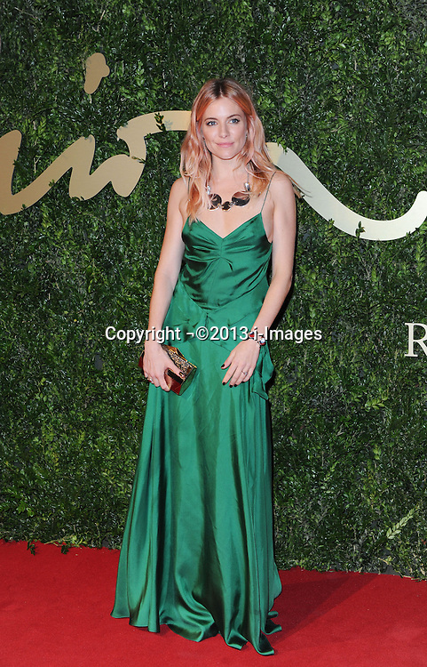 Sienna Miller arriving at the British Fashion Awards in London, Monday, 2nd December 2013. Picture by i-Images<br /> File photo - Jude Law NOTW Hacking.<br /> Jude Law is told relative sold story of girlfriend Sienna Miller's affair with Daniel Craig. Picture filed Tuesday, 28th January 2014.