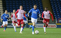 Marcus Maddison of Peterborough United gets away from Chris Stokes and Emmanuel Sonupe of Stevenage - Mandatory by-line: Joe Dent/JMP - 19/11/2019 - FOOTBALL - Weston Homes Stadium - Peterborough, England - Peterborough United v Stevenage - Emirates FA Cup first round replay