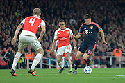 Bayern Munich striker Robert Lewandowski turns away from Arsenal striker Alexis Sanchez during the Champions League  Group F match between Arsenal and Bayern Munich at the Emirates Stadium, London, England on 20 October 2015. Photo by Alan Franklin.