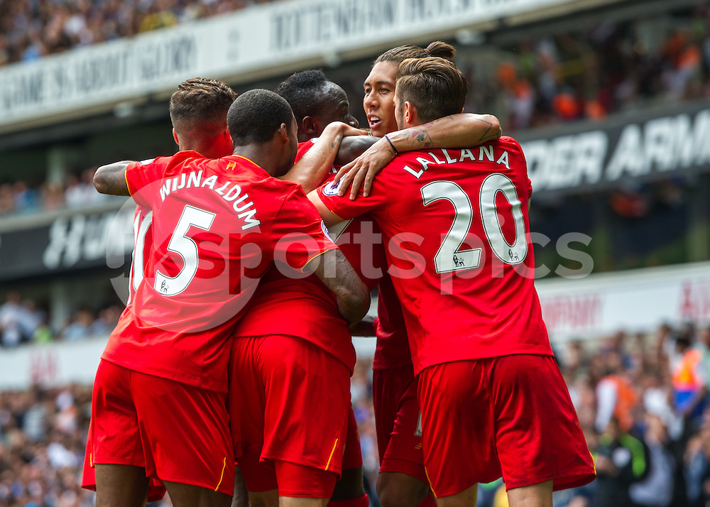 James Milner of Liverpool celebrates scoring the opening goal with his team mates during the Premier League match between Tottenham Hotspur and Liverpool at White Hart Lane, London, England on 27 August 2016. Photo by Vince  Mignott.