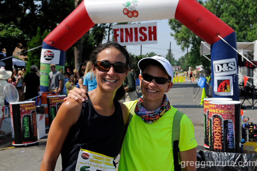 Michelle Travis and her Mom, Jenny Stinson, at the  finish line area during Emmett's Most Excellent Triathlon on August 7, 2010 at Blazer Park in downtown Emmett, Idaho.<br /> <br /> Travis finished the Olympic distance triathlon (1.5k swim, 40k bike and 10k run) in 3:21:50 and Jenny was there to cheer for her.