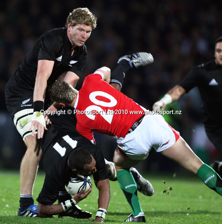 All Blacks winger Joe Rokocoko is upended by Tavis Knoyle.<br /> Steinlager Series international test match rugby - All Blacks v Wales at Carisbrook, Dunedin. Saturday 19 June 2010. Photo: Dave Lintott/PHOTOSPORT