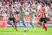 Marcus Harness (#19) of Portsmouth FC break away to score the opening goal during the EFL Sky Bet League 1 match between Sunderland and Portsmouth at the Stadium Of Light, Sunderland, England on 17 August 2019.