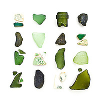 Sea glass bottle bits and fragments of china plates found on the beaches of Mount Desert Island, Maine. It's amazing what you can read from these fragments: 1950s Syracuse china, much older Bavarian porcelain, dark green bottle glass from the mid-1800s, and mid-20th century Coke bottle fragments.