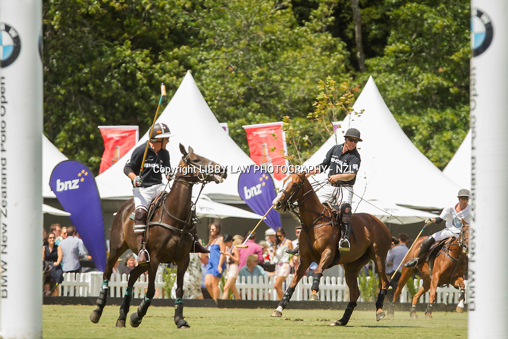 2014 NZL-BMW Polo Open: Clevedon - GAME 2: BMW (White) vs MOBILIS (Black): BMW Win:  (Sunday 23 February) CREDIT: Libby Law/Photosport COPYRIGHT: LIBBY LAW PHOTOGRAPHY - NZL