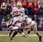 Michigan State's Keshawn Martin is tackled by Wisconsin's Chris Borland during the second half of the Big Ten conference championship NCAA college football game on Saturday, Dec. 3, 2011, in Indianapolis. (AP Photo/AJ Mast)
