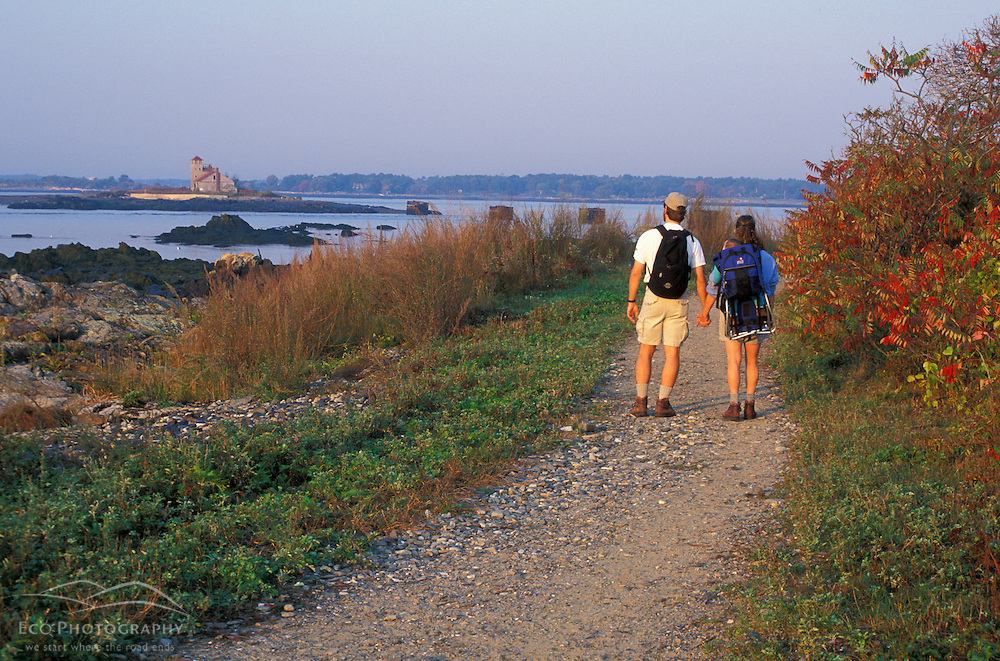Kittery, ME. A family walks a trail at Fort Foster State Park.