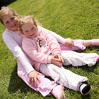 Mary and Jessica McDonagh enjoy the sunshine after the intercultural soccer tournament in Ennis on Saturday.<br /> Photograph by Yvonne Vaughan