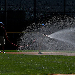 March 6, 2011; Dunedin, FL, USA; The grounds crew sprays the infield before a spring training game between the Toronto Blue Jays and the Philadelphia Phillies at Florida Auto Exchange Stadium. Mandatory Credit: Derick E. Hingle-USA TODAY SPORTS