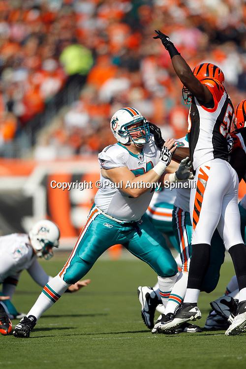 Miami Dolphins blocker Cory Procter (71) blocks Cincinnati Bengals defender Brandon Johnson (59) during a field goal attempt at the NFL week 8 football game against the Cincinnati Bengals on Sunday, October 31, 2010 in Cincinnati, Ohio. The Dolphins won the game 22-14. (©Paul Anthony Spinelli)