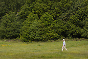 UNITED KINGDOM, London: 22 May 2019 <br /> A man walks through the greens of Parliament Hill in Hampstead Heath today. The warm weather is set to continue reaching up to temperatures of 22 C in the capital tomorrow.<br /> Rick Findler / Story Picture Agency
